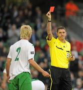 24 May 2011; Referee Craig Thomson shows Adam Thompson, Northern Ireland, a red card for his tackle on Republic of Ireland's Robbie Keane. Carling Four Nations Tournament, Republic of Ireland v Northern Ireland, Aviva Stadium, Lansdowne Road, Dublin. Picture credit: Brian Lawless / SPORTSFILE