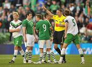 24 May 2011; Referee Craig Thomson issues Adam Thompson, left, Northern Ireland, a red card for his tackle on Republic of Ireland's Robbie Keane. Carling Four Nations Tournament, Republic of Ireland v Northern Ireland, Aviva Stadium, Lansdowne Road, Dublin. Picture credit: David Maher / SPORTSFILE
