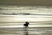 1 January 2017; A general view of a horse and jockey in action during the Ballyheigue Races on Ballyheigue beach on the edge of the North Atlantic ocean in Co. Kerry. Photo by Brendan Moran/Sportsfile