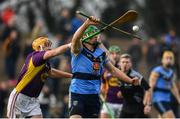 8 January 2017; Johny Murphy of UCD is tackled by David Redmond of Wexford during the Bord na Mona Walsh Cup Group 3 Round 1 match between Wexford and UCD at Páirc Uí Suíochan in Gorey, Co. Wexford. Photo by Ramsey Cardy/Sportsfile