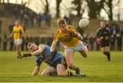 8 January 2017; Jim Rossiter of Wexford is tackled by Eoin Lowery of UCD during the Bord na Mona O'Byrne Cup Group 1 Round 1 match between Wexford and UCD at Páirc Uí Suíochan in Gorey, Co. Wexford.  Photo by Ramsey Cardy/Sportsfile