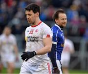 8 January 2017; Sean Johnston of Cavan  smiles as Mattie Donnelly of Tyrone walks off after receiving a red card during the second half of the Bank of Ireland Dr. McKenna Cup Section C Round 1 match between Cavan and Tyrone at Kingspan Breffni Park in Cavan. Photo by Oliver McVeigh/Sportsfile