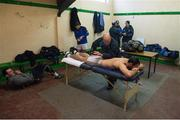 8 January 2017; Wicklow physio John Coyle works on Ross O'Brien, while the management team of Johnny Magee, Paddy Dalton, and PJ Cunningham discuss tactics in the background, ahead of the Bord na Mona O'Byrne Cup Group 3 Round 1 match between Meath and Wicklow at Páirc Táilteann in Navan, Co. Meath. Photo by Daire Brennan/Sportsfile