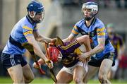 8 January 2017; Damien Reck of Wexford is tackled by Eddie Hayden, left, and Huw Lawlor of UCD during the Bord na Mona Walsh Cup Group 3 Round 1 match between Wexford and UCD at Páirc Uí Suíochan in Gorey, Co. Wexford. Photo by Ramsey Cardy/Sportsfile