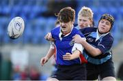 10 January 2017; Liam Skov of Templeogue College is tackled by Liam Hurley of Newpark Comprehsive during the Bank of Ireland Fr Godfrey Cup Round 1 match between Newpark Comprehensive and Templeogue College at Donnybrook Stadium in Donnybrook, Dublin. Photo by Cody Glenn/Sportsfile