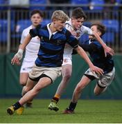 10 January 2017; Stephen Corry of Presentation College Bray evades the tackles of Alec Dawson, left, and Luan Ferriter of Mount Temple on his way to scoring his side's first try during the Bank of Ireland Fr Godfrey Cup Round 1 match between Presentation College Bray and Mount Temple at Donnybrook Stadium in Donnybrook, Dublin. Photo by Cody Glenn/Sportsfile