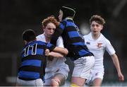 10 January 2017; Adam Kiernan of Presentation College Bray is tackled by Kevin Farrington, right, and Oisin K. Smith of Mount Temple during the Bank of Ireland Fr Godfrey Cup Round 1 match between Presentation College Bray and Mount Temple at Donnybrook Stadium in Donnybrook, Dublin. Photo by Cody Glenn/Sportsfile