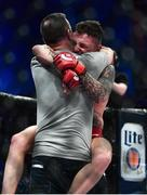 16 December 2016; James Gallagher celebrates with his Father following his victory over Anthony Taylor at Bellator169 in the 3 Arena in Dublin. Photo by Ramsey Cardy/Sportsfile