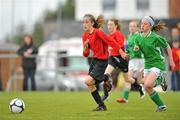 1 June 2011; Hannah Holden, St. Beacon's NS Mullinavat, Co. Kilkenny, in action against Rachel Baynes, Holy Family NS, Newport, Co. Mayo. FAI Schools 5-a-Side National Finals, St. Beacon's NS v Holy Family NS, Leah Victoria Park, Tullamore Town FC, Co. Offaly. Picture credit: Barry Cregg / SPORTSFILE