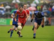 5 June 2011; Brian Dooher, Tyrone, in action against James Turley, Monaghan. Ulster GAA Football Senior Championship Quarter-Final, Healy Park, Tyrone v Monaghan, Omagh, Co. Tyrone. Picture credit: Oliver McVeigh / SPORTSFILE