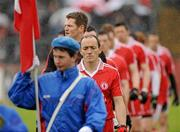 5 June 2011; Tyrone Captain Brian Dooher leads his team out during the parade. Ulster GAA Football Senior Championship Quarter-Final, Healy Park, Tyrone v Monaghan, Omagh, Co. Tyrone. Picture credit: Oliver McVeigh / SPORTSFILE