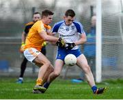 15 January 2017; Michael Bannigan of Monaghan in action against Conor Hamill of Antrim during the Bank of Ireland Dr. McKenna Cup Section B Round 2 match between Antrim and Monaghan at Glenavy in Co. Antrim. Photo by Mark Marlow/Sportsfile