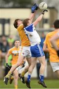 15 January 2017; Brian Greenan of Monaghan in action against Paddy McBride of Antrim  during the Bank of Ireland Dr. McKenna Cup Section B Round 2 match between Antrim and Monaghan at Glenavy in Co. Antrim. Photo by Mark Marlow/Sportsfile