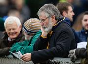 15 January 2017; Gerry Adams T.D. studies the team sheet during the Bank of Ireland Dr. McKenna Cup Section B Round 2 match between Antrim and Monaghan at Glenavy in Co. Antrim. Photo by Mark Marlow/Sportsfile