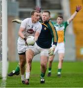 15 January 2017; Tommy Moolick of Kildare in action against Offaly goalkeeper Alan Mulhall during the Bord na Mona O'Byrne Cup Group 2 Round 3 match between Offaly and Kildare at O'Connor Park in Tullamore, Co Offaly. Photo by Piaras Ó Mídheach/Sportsfile