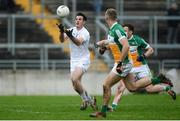 15 January 2017; Eoin Doyle of Kildare in action against Jason Gethings and Shane Nally, behind, of Offaly during the Bord na Mona O'Byrne Cup Group 2 Round 3 match between Offaly and Kildare at O'Connor Park in Tullamore, Co Offaly. Photo by Piaras Ó Mídheach/Sportsfile