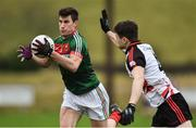 15 January 2017; Alan Freeman of Mayo in action against  Philip Nielan of Sligo IT during the Connacht FBD League Section A Round 2 match between Mayo and Sligo IT at James Stephen's Park in Ballina, Co Mayo. Photo by David Maher/Sportsfile