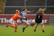 5 June 2011; Laura McEnaney, Monaghan, in action against Sinead McCoy and Catherine McAlinden, Armagh. Ulster Ladies Football Senior Championship, Armagh v Monaghan, Armagh v Monaghan, Healy Park, Omagh, Co. Tyrone. Picture credit: Oliver McVeigh / SPORTSFILE