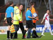 10 June 2011; Sligo Rovers manager Paul Cook has words with referee Damien Hancock at half-time. Airtricity League Premier Division, Bohemians v Sligo Rovers, Dalymount Park, Dublin. Picture credit: Brian Lawless / SPORTSFILE