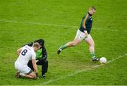 15 January 2017; Tommy Moolick of Kildare is treated for an injury as Offaly goalkeeper Alan Mulhall takes a kickout during the Bord na Mona O'Byrne Cup Group 2 Round 3 match between Offaly and Kildare at O'Connor Park in Tullamore, Co Offaly. Photo by Piaras Ó Mídheach/Sportsfile
