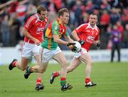 12 June 2011; Paul Cashin, Carlow, in action against Michael Manning, left, and Ray Finnegan, Louth. Leinster GAA Football Senior Championship Quarter-Final, Carlow v Louth, O'Moore Park, Portlaoise, Co. Laois. Picture credit: Matt Browne / SPORTSFILE