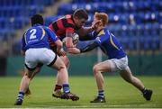18 January 2017; David Young of Kilkenny College is tackled by Conor Craig, left, and Charles Flynn of Wilsons Hospital during the Bank of Ireland Vinnie Murray Cup Round 2 match between Kilkenny College and Wilsons Hospital at Donnybrook Stadium in Donnybrook, Dublin. Photo by Cody Glenn/Sportsfile