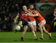 18 January 2017; Ryan Mallon of Down  having his shot blocked down by Stephen Sheridan of Armagh during the Bank of Ireland Dr. McKenna Cup Section A Round 3 match between Armagh and Down at the Athletic Grounds in Armagh. Photo by Oliver McVeigh/Sportsfile