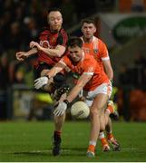 18 January 2017; Ryan Mallon of Down in action against Stephen Sheridan of Armagh during the Bank of Ireland Dr. McKenna Cup Section A Round 3 match between Armagh and Down at the Athletic Grounds in Armagh. Photo by Oliver McVeigh/Sportsfile