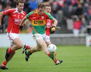 12 June 2011; Paul Cashin, Carlow, in action against Michael Manning, Louth. Leinster GAA Football Senior Championship Quarter-Final, Carlow v Louth, O'Moore Park, Portlaoise, Co. Laois. Picture credit: Matt Browne / SPORTSFILE