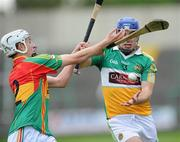 15 June 2011; Brian Carroll, Offaly, in action against Alan Corcoran, Carlow. Walsh Cup Shield Final, Carlow v Offaly, O'Moore Park, Portlaoise, Co. Laois. Picture credit: Matt Browne / SPORTSFILE