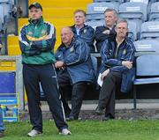 15 June 2011; Offaly county board chairman Pat Teehan, right, and county board secretary Tony Murphy watch Offaly in action against Carlow with team manager Joe Dooley, left. Walsh Cup Shield Final, Carlow v Offaly, O'Moore Park, Portlaoise, Co. Laois. Picture credit: Matt Browne / SPORTSFILE