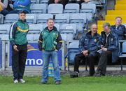 15 June 2011; Offaly manager Joe Dooley, left, and selector Pat McLoughney watch their team in action as county board chairman Pat Teehan, right, and county board secretary Tony Murphy sit on the team bench. Walsh Cup Shield Final, Carlow v Offaly, O'Moore Park, Portlaoise, Co. Laois. Picture credit: Matt Browne / SPORTSFILE