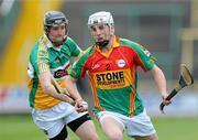 15 June 2011; Alan Corcoran, Carlow, in action against James Mulrooney, Offaly. Walsh Cup Shield Final, Carlow v Offaly, O'Moore Park, Portlaoise, Co. Laois. Picture credit: Matt Browne / SPORTSFILE