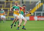 15 June 2011; Dylan Hayden, Carlow, in action against Ruairi Dunbar, Offaly. Walsh Cup Shield Final, Carlow v Offaly, O'Moore Park, Portlaoise, Co. Laois. Picture credit: Matt Browne / SPORTSFILE