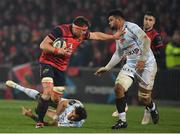 21 January 2017; CJ Stander of Munster is tackled by So'otala Fa'aso'o of Racing 92 during the European Rugby Champions Cup Pool 1 Round 6 match between Munster and Racing 92 at Thomond Park in Limerick. Photo by Brendan Moran/Sportsfile