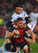 21 January 2017; CJ Stander of Munster is tackled by Brice Dulin, left, and Teddy Thomas of Racing 92 during the European Rugby Champions Cup Pool 1 Round 6 match between Munster and Racing 92 at Thomond Park in Limerick. Photo by Brendan Moran/Sportsfile