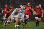 21 January 2017; CJ Stander of Munster breaks clear of the tackle of Henry Chavancy of Racing 92 during the European Rugby Champions Cup Pool 1 Round 6 match between Munster and Racing 92 at Thomond Park in Limerick.  Photo by Brendan Moran/Sportsfile