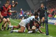21 January 2017; Ronan O'Mahony of Munster is tackled short of the try line by Teddy Thomas and Brice Dulin of Racing 92 during the European Rugby Champions Cup Pool 1 Round 6 match between Munster and Racing 92 at Thomond Park in Limerick. Photo by Brendan Moran/Sportsfile