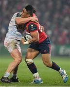 21 January 2017; Francis Saili of Munster is tackled by Camille Chat of Racing 92 during the European Rugby Champions Cup Pool 1 Round 6 match between Munster and Racing 92 at Thomond Park in Limerick. Photo by Brendan Moran/Sportsfile