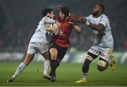 21 January 2017; Tyler Bleyendaal of Munster is tackled by Etienne Dussartre, left, and Leone Nakarawa of Racing 92 during the European Rugby Champions Cup Pool 1 Round 6 match between Munster and Racing 92 at Thomond Park in Limerick. Photo by Diarmuid Greene/Sportsfile