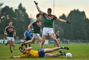 22 January 2017; John McManus of Roscommon in action against Conor O'Shea of Mayo the Connacht FBD League Section A Round 3 match between Roscommon and Mayo at St. Brigids GAA Club in Kiltoom, Co. Roscommon. Photo by Ramsey Cardy/Sportsfile