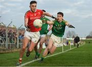 22 January 2017; Andy McDonnell of Louth in action against Donal Keogan, left, and Cian O'Brien of Meath during the Bord na Mona O'Byrne Cup semi-final match between Meath and Louth at Páirc Táilteann in Navan, Co. Meath. Photo by David Fitzgerald/Sportsfile