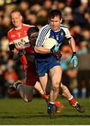 22 January 2017; Karl O'Connell of Monaghan in action against Enda Lynn of Derry during the Bank of Ireland Dr. McKenna Cup semi-final match between Monaghan and Derry at Athletic Grounds in Armagh. Photo by Philip Fitzpatrick/Sportsfile