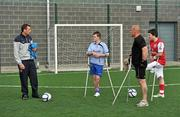 18 June 2010; Denis Hyland, left, Development Officer at the Football Association of Ireland, speaking to footballers, from left, Craig Dowling, from Carlow town, Simon Baker, from Limerick, and James Boyle, from Dunloe, Co. Donegal, during Ireland's first amputee football club training session. Mountview Communinty Sports Centre, Clonsilla, Co. Dublin. Picture credit: Brendan Moran / SPORTSFILE