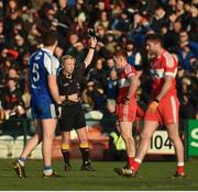 22 January 2017; Referee Ciaran Branagan giving Conor McAtamney of Derry a black card during the Bank of Ireland Dr. McKenna Cup semi-final match between Monaghan and Derry at Athletic Grounds in Armagh. Photo by Philip Fitzpatrick/Sportsfile