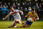 22 January 2017; Donie Smith of Roscommon is tackled by Rob Hennelly of Mayo during the Connacht FBD League Section A Round 3 match between Roscommon and Mayo at St. Brigids GAA Club in Kiltoom, Co. Roscommon.  Photo by Ramsey Cardy/Sportsfile
