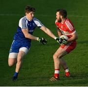 22 January 2017; Emmet McGuckin of Derry in action against Darren Hughes of Monaghan during the Bank of Ireland Dr. McKenna Cup semi-final match between Monaghan and Derry at Athletic Grounds in Armagh. Photo by Philip Fitzpatrick/Sportsfile