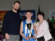 25 January 2017; Iarlaith O'Sullivan of St Josephs Bish Galway is presented with the cup by Jason Killeen and Theresa Walsh, President of Basketball Ireland, after the Subway All-Ireland Schools U16A Boys Cup Final match between St Joes Bish and St Malachys College at the National Basketball Arena in Tallaght, Co Dublin. Photo by Eóin Noonan/Sportsfile