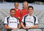 21 June 2011; Ulster Bank GAA stars Craig Dias, left, and Rory O'Carroll pictured with pupils Curtis Ward and Ella Small, from St. Joseph's Primary School, Newcastle, Co. Down, in Croke Park as part of the Ulster Bank/Irish News competition where five lucky classes won a school trip of a lifetime which included a tour of the famous Croke Park Stadium while also meeting some of the biggest GAA stars in the country. Croke Park, Dublin. Picture credit: Barry Cregg / SPORTSFILE