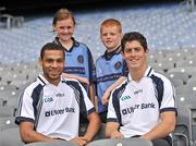21 June 2011; Ulster Bank GAA stars Craig Dias, left, and Rory O'Carroll pictured with pupils Aoife Moran and Ciaran Shields, from Holy Family Primary School, Magherafelt, Co. Derry, in Croke Park as part of the Ulster Bank/Irish News competition where five lucky classes won a school trip of a lifetime which included a tour of the famous Croke Park Stadium while also meeting some of the biggest GAA stars in the country. Croke Park, Dublin. Picture credit: Barry Cregg / SPORTSFILE